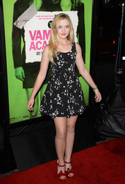 Kathryn Newton charmed at the 'Vampire Academy' premiere in a Miu Miu mini dress printed with musical notes.
