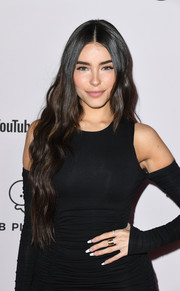 Madison Beer accessorized with an eternity band along with some stackable gold rings at the premiere of 'Justin Bieber: Seasons.'
