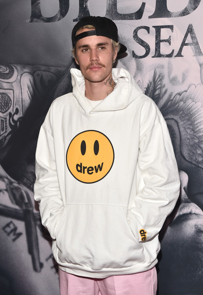 Justin Bieber donned a cute white hoodie from his own Drew House line for the premiere of 'Justin Bieber: Seasons.'