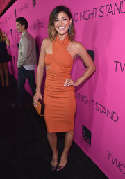 Jessica Szohr matched her dress with an orange Oroton box clutch.