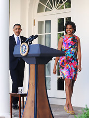 Michelle Obama's print dress and yellow strappy sandals at the Cinco de Mayo celebration were a vibrant pairing.