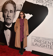 Tina Fey arrived for the Broadway opening of 'Present Laughter' wearing a camel-colored wool coat by Max Mara.