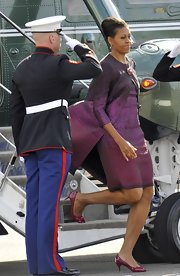 Michelle Obama stepped out for the G8 Summit wearing red pumps with a purple dress.