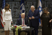 Melania Trump was business-chic in a belted white skirt suit by Michael Kors while visiting the Israeli President.