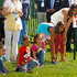 (AFP OUT) Malia Obama (R), Sasha Obama (2nd R) and other children wait for the starting whistle during the White House Easter Egg Roll on the South Lawn of the White House April 25, 2011 in Washington, DC. About 30,000 people are expected to attend the 133-year-old tradition of rolling colored eggs down the White House lawn.