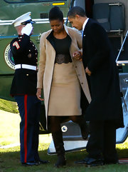 Michelle Obama chose a stylish structured look with this beige coat and skirt set for her trip back to the White House from Norway.