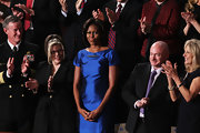 Michelle Obama was a standout in an iridescent blue cocktail dress at the State of the Union Address.