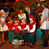 "(AFP OUT) U.S. President Barack Obama (2nd R), first lady Michelle Obama (L), and daughters Malia (R) and Sasha (2nd L) greet Christmas elves as they attend the ""Christmas in Washington"" concert at the National Building Museum on December 9, 2012 in Washington, D.C. The concert benefits the National Childrens Medical Center and is hosted by comedian Conan O'Brien."
