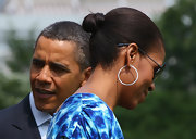 Michelle Obama sported a tight hair knot when she left the White House for Camp David.