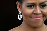 Michelle Obama contrasted her heavy eye makeup with a soft pink lip.