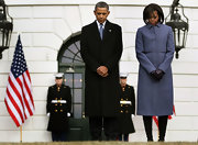 Michelle Obama chose a stylish gray wool coat with waist detailing for a ceremony honoring the Tucson shooting victims.