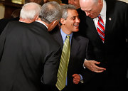 Rahm jazzed up his classic suit with a lime green striped tie.