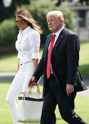 Melania Trump departed the White House for New Jersey carrying an oversized white, green, and yellow tote by Burberry.