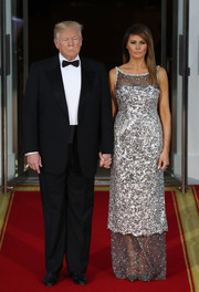 Melania Trump radiated in a silver sequin gown by Chanel while hosting a State Dinner for the French President.