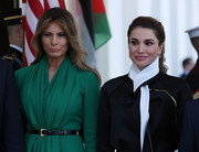 Melania Trump welcomed Queen Rania to the White House wearing a green dress cinched in with an elegant black belt.