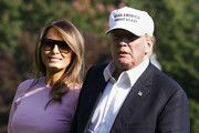 Melania Trump kept the sun out with a pair of rectangular tortoiseshell shades as she returned to the White House from New Jersey.