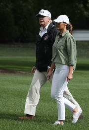 Melania Trump ditched the heels in favor of these white Converse sneakers during her trip back to the White House from Florida.
