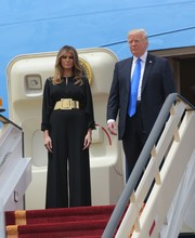 Melania Trump looked glam in a loose black Stella McCartney jumpsuit with an oversized gold belt as she arrived in Riyadh.