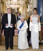 Melania Trump kept it undestated yet elegant in a sleeveless, sheer-yoke white gown by Dior Couture while attending a State Banquet at Buckingham Palace.