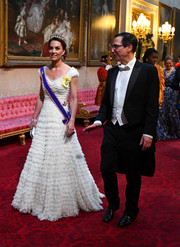 Kate Middleton attended a State Banquet at Buckingham Palace wearing a white ruffle ballgown by Alexander McQueen.