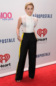 Miley Cyrus actually normal in a sleeveless white button-down during Jingle Ball.