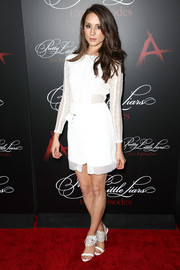 Troian Bellisario complemented her dress with chic white Alexandre Birman sandals featuring wide ankle straps with cutout detailing.