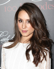 Troian Bellisario wore her hair long and wavy at the 'Pretty Little Liars' 100th episode celebration.
