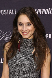 Troian Bellisario left her long hair loose with a side part for the 'Pretty Little Liars' fashion launch.