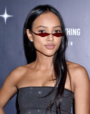 Karrueche Tran went casual with this loose straight hairstyle at the PrettyLittleThing x Hailey Baldwin launch.