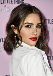 Olivia Culpo framed her gorgeous face with this center-parted wavy 'do for the launch of her PrettyLittleThing collection.