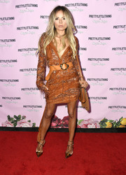 Erica Pelosini completed her look with strappy gold pumps.