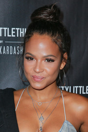 Christina Milian worked a cute top knot at the PrettyLittleThing by Kourtney Kardashian launch.