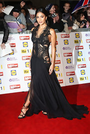 The 'X-Factor' star exuded gothic elegance from top to toe in a gorgeous pair of strappy heels.