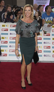Sally Gunnell wore a printed gray blouse with a green pencil skirt for a sophisticated finish at the Pride of Britain Awards.