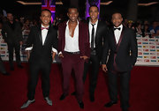 Oritse Williams stood out in a sea of black suits with his burgundy outfit.