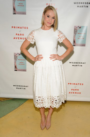 Becca Tobin kept it ladylike in a little white dress with a laser-cut hem and sleeves during the 'Primates of Park Avenue' release event.