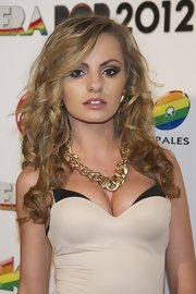Singer Alexandra Stan defined her dark eyes with dramatic winged-out liner.