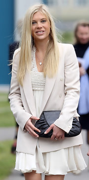 Chelsy Davy layered an oversize cream boyfriend blazer over her empire waist dress.