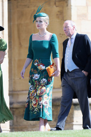 Kitty Spencer's orange velvet clutch at the royal wedding worked beautifully with her green floral dress.