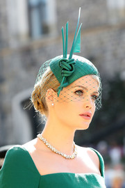 Lady Kitty Spencer finished off her coiffure with a veiled green fascinator by Philip Treacy.