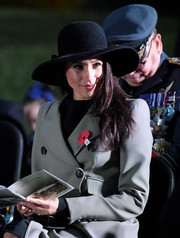 Meghan Markle paired a wide-brimmed hat with a double-breasted coat for an Anzac Day dawn service.