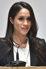 Meghan Markle wore her long hair down in a side-parted style with feathery ends at the Endeavour Fund Awards.