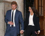 Meghan Markle paired a white Tuxe Bodywear pussybow blouse with a black suit for the Endeavour Fund Awards.