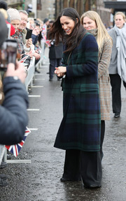 Meghan Markle kept warm in a Burberry double-breasted tartan wool coat for her visit to Edinburgh Castle.