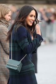 Meghan Markle visited Edinburgh Castle carrying a chic green chain-strap bag by Strathberry.