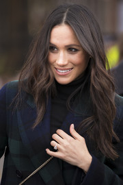 Meghan Markle styled her hair into a feathered flip for her visit to Edinburgh Castle.