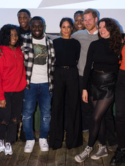 Meghan Markle kept it low-key in a black crewneck sweater from Marks & Spencer while visiting Reprezent 107.3 FM.