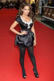 Preeya completed her theatrical-looking mini dress with sheer black tights and a pair off peep-toed, platform pumps.