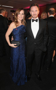 Geri Halliwell paired her dress with a black woven-leather clutch.