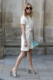 Sienna Miller infused subtle color into her look with a pastel blue floral-appliqued clutch.